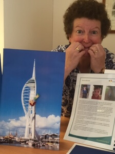 Image of the Spinnaker Tower with toy lady suspending mid descent created to inspire Doreen.
