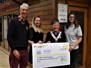 Hartley Wintney Pram Race l-r Steve Watling, Laura Roberts and Betty Key present cheque to Lucy Gray